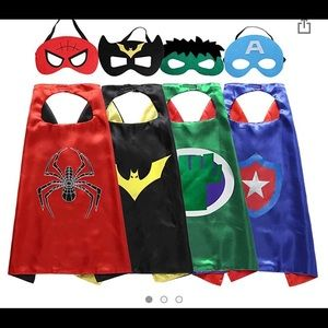 Set of four superhero capes and masks